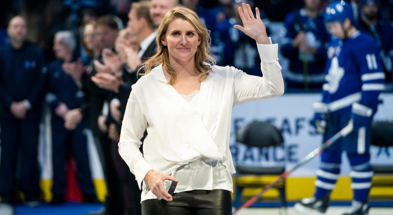 TORONTO, ON - NOVEMBER 15: 2019 Hockey Hall of Fame inductee Hayley Wickenheiser waves to the crowd during a pre-game ceremony at the Scotiabank Arena on November 15, 2019 in Toronto, Ontario, Canada. The Toronto Maple Leafs face the Boston Bruins. (Photo by Mark Blinch/NHLI via Getty Images)