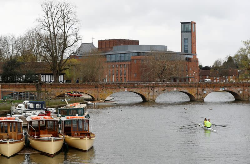 FILE PHOTO: The Royal Shakespeare Company's theatre complex is seen beyond the foot-bridge in Stratford-upon-Avon
