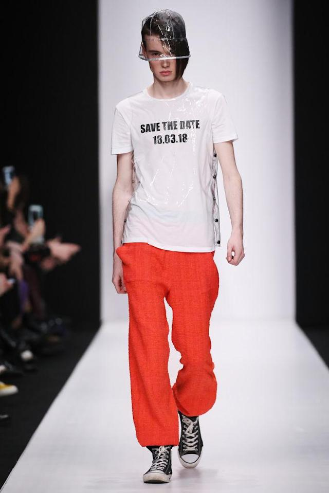 "<p>A model wears a political statement tee that reads ""Save the Date, 18.03.18"" at the Atelier Gala B runway show during Mercedes-Benz Fashion Week Russia. (Photo: Getty Images) </p>"