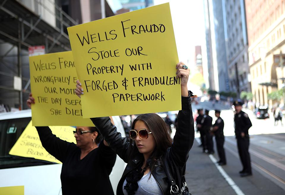 Protestors hold signs during a demonstration outside of the Wells Fargo shareholders meeting in 2011 in San Francisco, California. Over 100 housing activists staged a demonstration outside of the Wells Fargo shareholders meeting accusing the banking giant of predatory lending and foreclosing on homes by using fradulent paperwork. (Photo: Justin Sullivan/Getty Images)