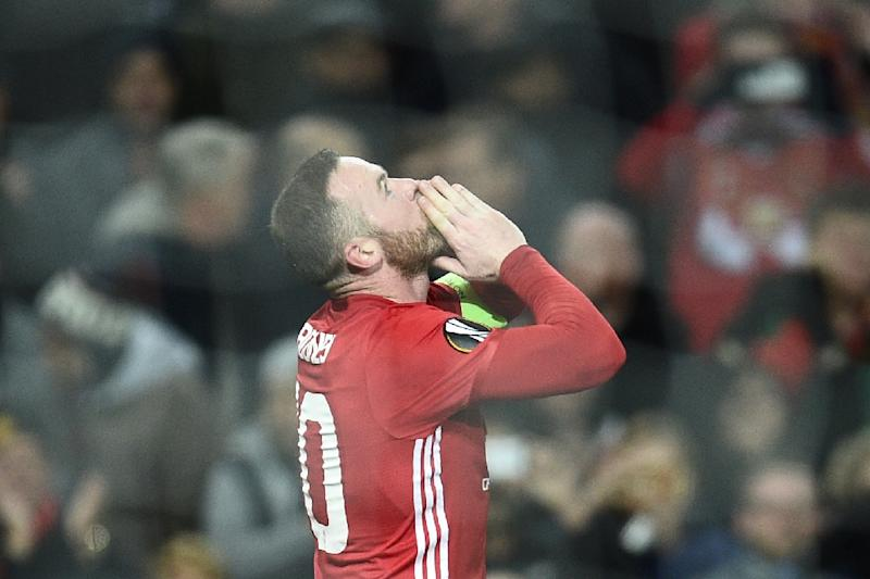 Manchester United's English striker Wayne Rooney celebrates scoring the opening goal during the UEFA Europa League group A football match between Manchester United and Feyenoord in England, on November 24, 2016