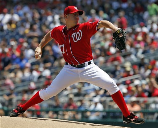 Washington Nationals starting pitcher Jordan Zimmermann (27) throws during the first inning of a baseball game againstthe New York Yankees at Nationals Park on Saturday, June 16, 2012 in Washington.  (AP Photo/Alex Brandon)