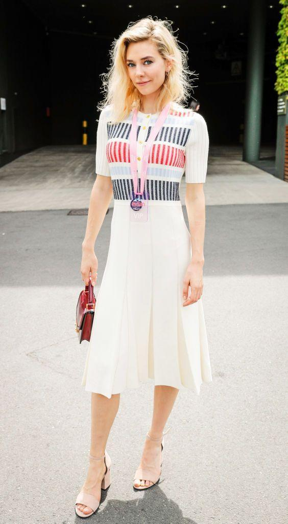 <p>Vanessa Kirby posed for the camera at Wimbledon in a simple 3/4 sleeve length dress with red and blue detailing.</p>