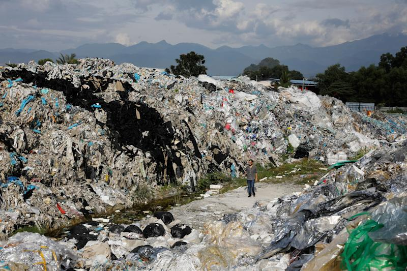 Mountains of plastic waste dumped outside an illegal recycling facility in Malaysia.  (Photo: Joshua Paul for HuffPost)