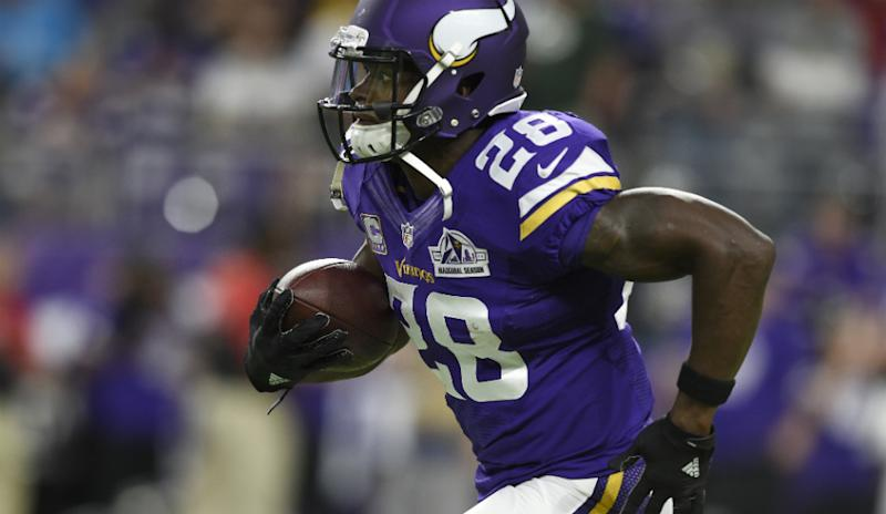 Adrian Peterson running down the field with the ball