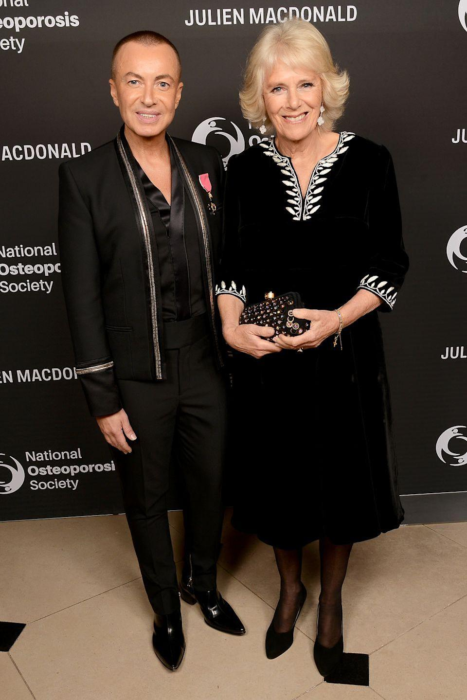 <p>The Duchess of Cornwall recycled a black velvet dress from earlier this month to attend the Julien Macdonald, on the left, Fashion Show for the National Osteoporosis Society. </p>