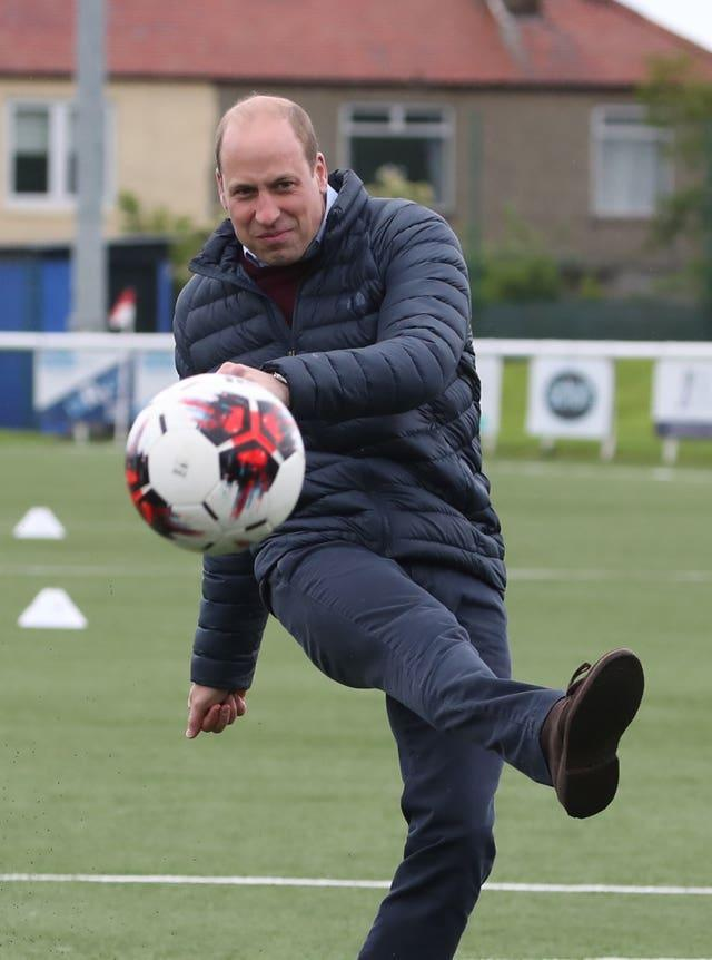 William shows off his football skills during his visit to the Edinburgh club