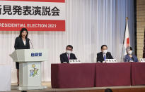 A candidate of the ruling Liberal Democratic Party (LDP) presidential election, Seiko Noda, left, delivers a campaign speech while other candidates Administrative Reform Minister Taro Kono second left, former Foreign Minister Fumio Kishida, second right, and former Internal Affairs Minister Sanae Takaichi listen Friday, Sept. 17, 2021, in Tokyo. The presidential election to choose successor of Prime Minister Yoshihide Suga will be voted on Sept. 29. (Yoshikazu Tsuno/Pool Photo via AP)