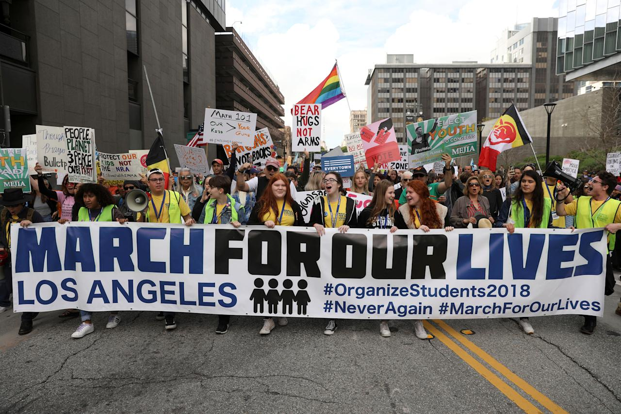 "<p>People walk with signs during ""March for Our Lives"", an organized demonstration to end gun violence, in downtown Los Angeles, California, U.S., March 24, 2018. (Patrick T. Fallon/Reuters) </p>"