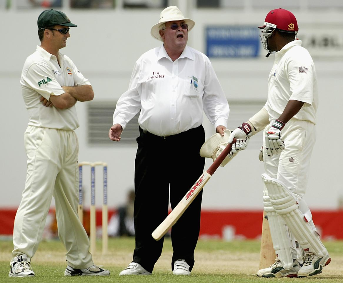 ST JOHN'S, ANTIGUA - MAY 10:  Umpire David Shepherd comes between Steve Waugh of Australia and Brian Lara of the West Indies during day two of the fourth test between the West Indies and Australia played on May 10, 2003 at the Recreation Oval in St John's, Antigua. (Photo by Hamish Blair/Getty Images)