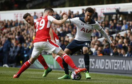 Britain Football Soccer - Tottenham Hotspur v Arsenal - Premier League - White Hart Lane - 30/4/17 Tottenham's Dele Alli in action with Arsenal's Granit Xhaka and Mesut Ozil Action Images via Reuters / Paul Childs Livepic