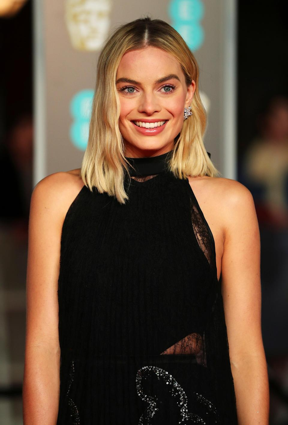 Margot Robbie lights up the night with her smile.