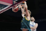 Australia's Jock Landale (13) scores past Italy's Nicolo Melli (9) during a men's basketball preliminary round game at the 2020 Summer Olympics, Wednesday, July 28, 2021, in Saitama, Japan. (AP Photo/Eric Gay)