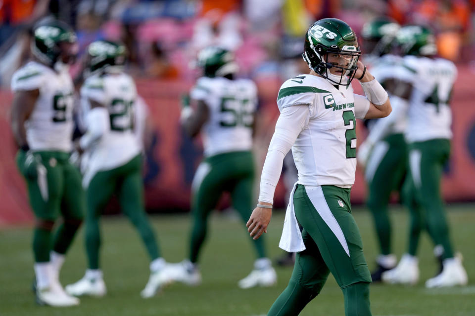 New York Jets quarterback Zach Wilson (2) walks to his bench during the second half of an NFL football game against the Denver Broncos, Sunday, Sept. 26, 2021, in Denver. The Broncos won 26-0. (AP Photo/David Zalubowski)