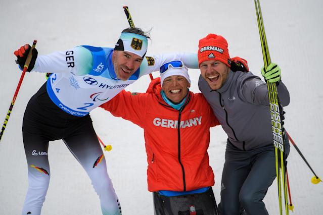 (From L) Alexander Ehler of Germany and his teammates Andrea Eskau and Steffen Lehmker celebrate after the Cross Country Skiing 4x2.5km Mixed Relay at the Alpensia Biathlon Centre. The Paralympic Winter Games, PyeongChang, South Korea, Sunday 18th March 2018. OIS/IOC/Thomas Lovelock/Handout via Reuters