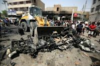 Baghdad market bombing claimed by IS kills 64