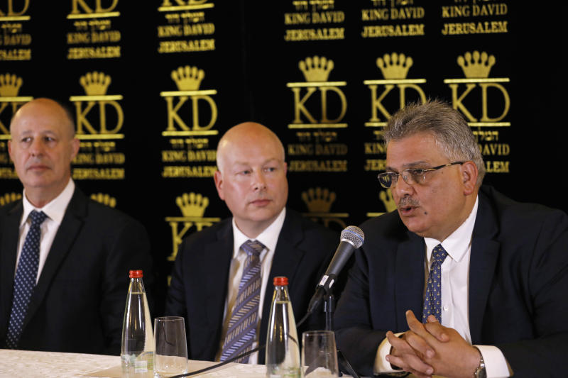 U.S. President Donald Trump's Middle East envoy, Jason Greenblatt, center, Israeli Minister of Regional Cooperation Tzachi Hanegbi, left, and the head of the Palestinian Water Authority, Mazen Ghoneim give a news conference about a water-sharing agreement, in Jerusalem, Thursday, July 13, 2017. Greenblatt announced Thursday that Israel and the Palestinians reached a water agreement linked to a massive planned Red Sea-Dead Sea pipeline project. (Ronen Zvulun/Pool, via AP)