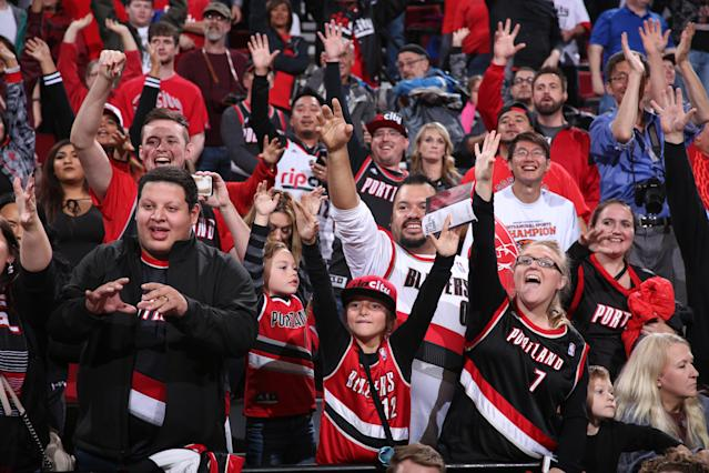 "Fans of the <a class=""link rapid-noclick-resp"" href=""/nba/teams/por/"" data-ylk=""slk:Portland Trail Blazers"">Portland Trail Blazers</a> participate in the team's annual Fan Fest event October 1, 2017 at the Moda Center in Portland, Oregon. (Sam Forencich/NBAE/Getty Images)"