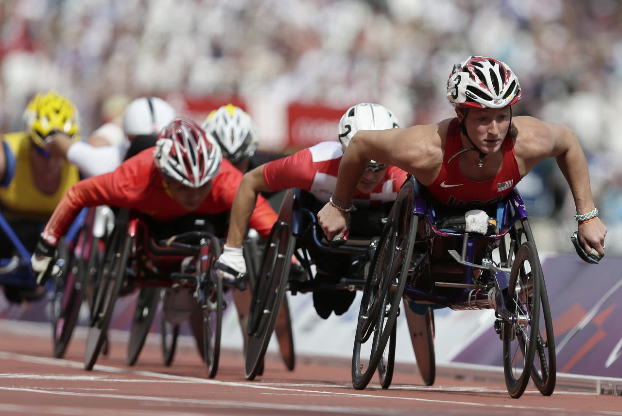 Tatyana McFadden of the United Sates, right looks as she competes in a women's 1500-meter T54 category heat at the 2012 Paralympics games, Thursday, Sept. 6, 2012, in London. (AP Photo/Alastair Grant)
