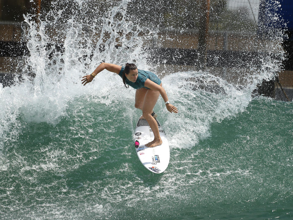 Surfer Johanne Defay, of France, works out on a Surf Ranch wave during practice rounds for the upcoming Olympics Wednesday, June 16, 2021, in Lemoore, Calif. Defay is headed to the Olympics for surfing's debut at the Games, buoyed by an upset win against reigning world champion Carissa Moore, 28, at the high-intensity Surf Ranch competition last month. Though there's much excitement and renewed enthusiasm for the women's game, the objectification, pay disparities and opportunity gap have taken its toll. Industry leaders say they're committed to righting the wrongs that have long held female surfers back in the male-dominated sport. The mental, financial and logistical roadblocks for women in surfing date back centuries. (AP Photo/Gary Kazanjian)