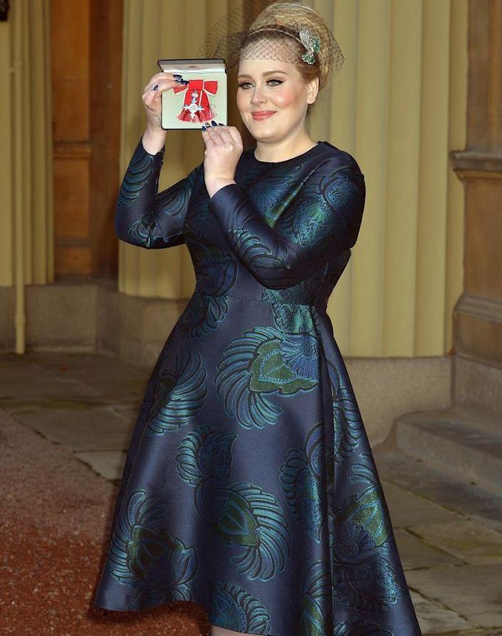 <p>Adele opted for an embroidered navy A-line dress and a statement headpiece for her visit to receive an OBE from the Queen. And just like that, I'm not bored by blue dresses anymore. </p>