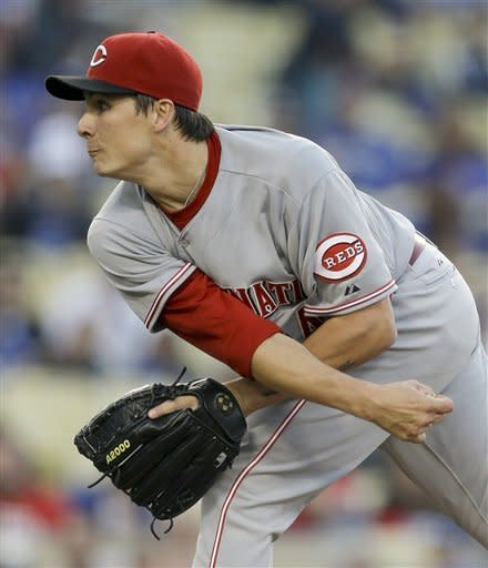 Cincinnati Reds starting pitcher Homer Bailey throws to the Los Angeles Dodgers during the first inning of a baseball game in Los Angeles, Monday, July 2, 2012. (AP Photo/Chris Carlson)