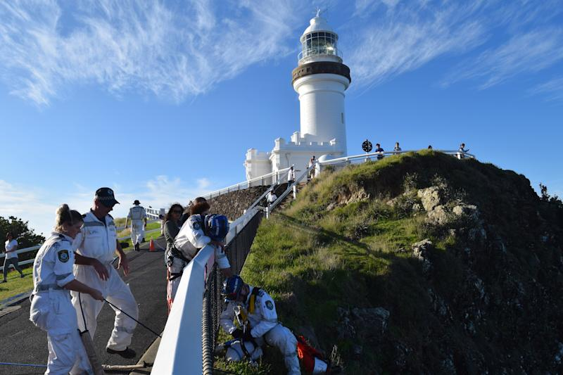 NSW Police search near a lighthouse in Byron Bay for the 18-year-old backpacker who went missing in May after leaving Cheeky Monkey's..