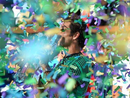Mar 19, 2017; Indian Wells, CA, USA; Roger Federer (SUI) celebrates as confetti falls after he defeated Stan Wawrinka (not pictured) 7-6, 6-4 in the men's final in the BNP Paribas Open at the Indian Wells Tennis Garden. Mandatory Credit: Jayne Kamin-Oncea-USA TODAY Sports