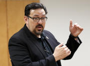 """FILE - In this Nov. 6, 2018, file photo, then Maricopa County Recorder Adrian Fontes speaks at the Tabulation and Election Center in Phoenix. Republicans in several key states are imposing voting restrictions this year that Democrats say will disproportionally affect their voters. """"When you restrict access by reducing opportunities for voters, you are suppressing the vote for all voters,"""" said Fontes. """"Many of the restrictions being proposed by Republicans are effectively a product of their ignorance of the voting habits of their own constituents."""" (AP Photo/Matt York, File)"""