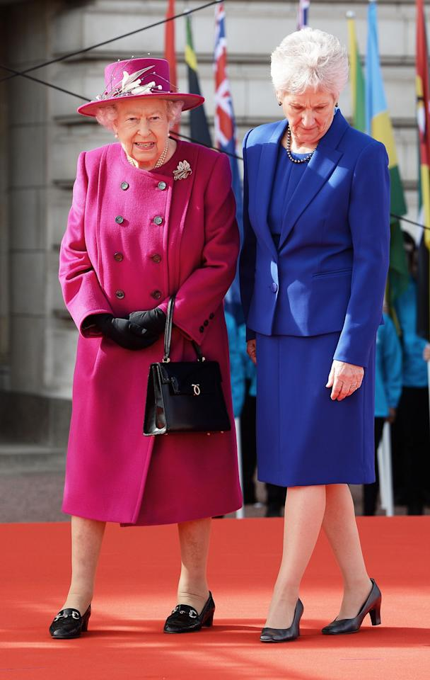 <p>A hot pink look was seen at the 2017 Commonwealth Day.<br /><i>[Photo: PA]</i> </p>