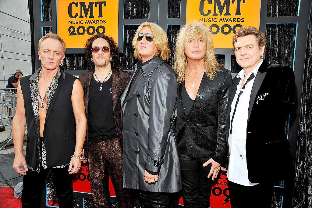 "Def Leppard's Phil Collen, Vivian Campbell, Joe Elliott, Rick Savage, and one-armed drummer Rick Allen desperately needed to tone their rockin' ensembles down a bit. Kevin Mazur/<a href=""http://www.wireimage.com"" target=""new"">WireImage.com</a> - June 16, 2009"