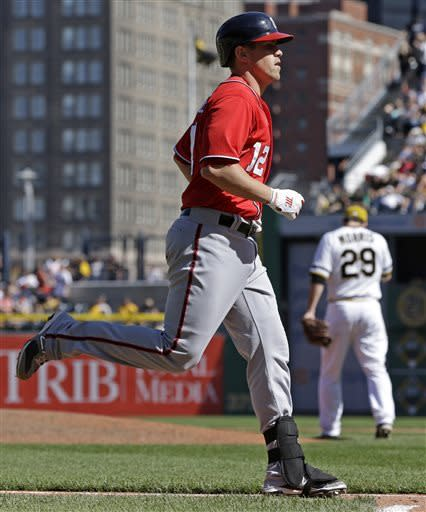 Washington Nationals' Tyler Moore (12) rounds third after hitting a three-run home run off Pittsburgh Pirates pitcher Bryan Morris (29) in the eighth inning of a baseball game in Pittsburgh, Sunday, May 5, 2013. (AP Photo/Gene J. Puskar)