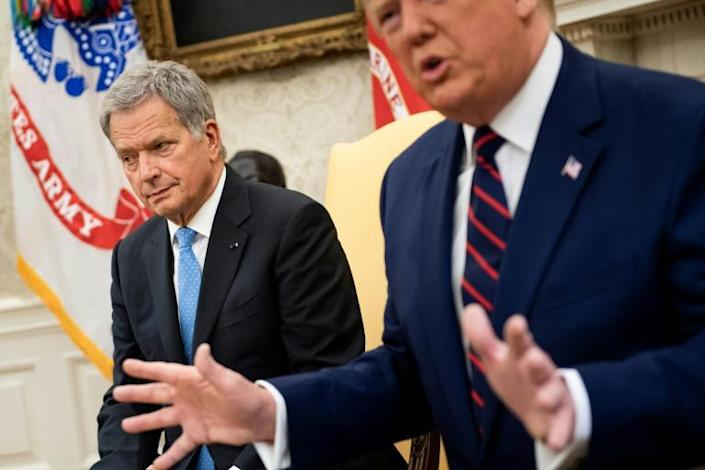 Finland's President Sauli Niinisto (L) looks to one side as his host US President Donald Trump vents to journalists over a Democratic-led impeachment investigation (AFP Photo/Brendan Smialowski)