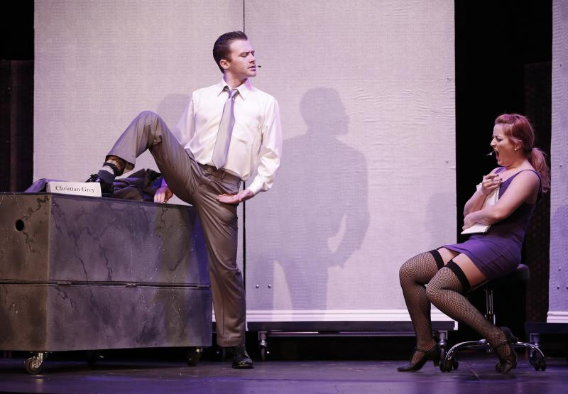 """This theater publicity image released by David Gersten & Associates shows Matthew Brian Bagley, left, and Laurie Elizabeth Gardner during a performance of """"Cuff Me: The Fifty Shades of Grey (Unauthorized) Musical Parody,"""" in New York. (AP Photo/David Gersten & Associates, Carol Rosegg)"""