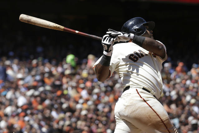 San Francisco Giants' Pablo Sandoval hits a sacrifice fly to score Hunter Pence during the seventh inning of a baseball game against the Washington Nationals in San Francisco, Thursday, June 12, 2014. (AP Photo/Jeff Chiu)