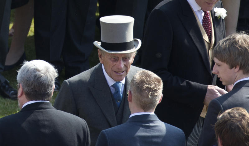 "Prince Philip, center, the husband of Britain's Queen Elizabeth II attends a garden party at Buckingham Palace in London, Thursday, June 6, 2013. Buckingham Palace says Queen Elizabeth II's husband was later admitted to a London hospital for an exploratory operation. The palace said the operation on 91-year-old Prince Philip will come after ""abdominal investigations,"" but did not elaborate. (AP Photo/Matt Dunham, Pool)"