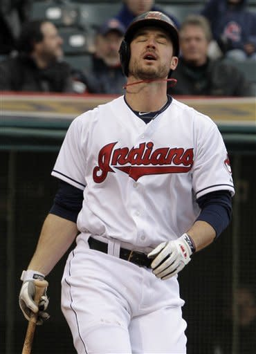 Cleveland Indians' Jack Hannahan reacts as he is struck out by Chicago White Sox starting pitcher John Danks in the fourth inning of a baseball game in Cleveland on Wednesday, April 11, 2012. (AP Photo/Amy Sancetta)