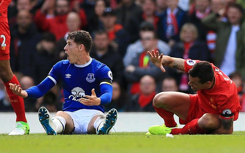 Ross Barkley protests his innocence after his heavy challenge on Dejan Lovren  - PA