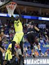 <p>Baylor forward Jo Lual-Acuil Jr. (0) of Australia dunks the ball in front of New Mexico State guard Matt Taylor (24) during a first-round game in the men's NCAA college basketball tournament in Tulsa, Okla., Friday March 17, 2017. (AP Photo/Tony Gutierrez) </p>