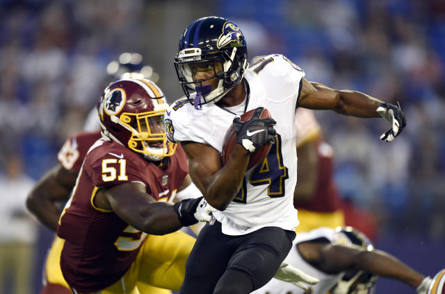 Baltimore Ravens wide receiver Tim White, right, rushes against Washington Redskins linebacker Shaun Dion Hamilton in the first half of a preseason NFL football game, Thursday, Aug. 30, 2018, in Baltimore. (AP Photo/Gail Burton)