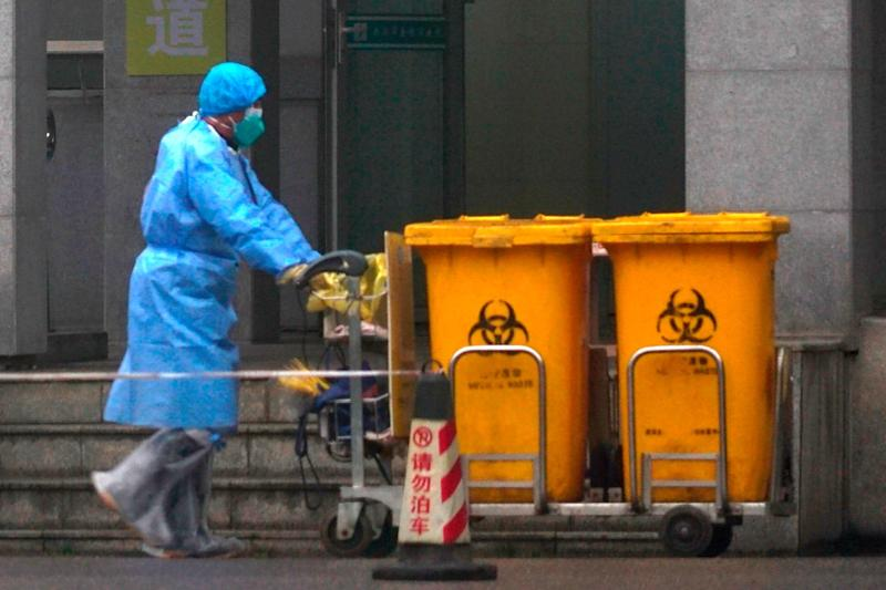 The shares in companies making surgical masks in gloves have risen with the news of the outbreak (AP)
