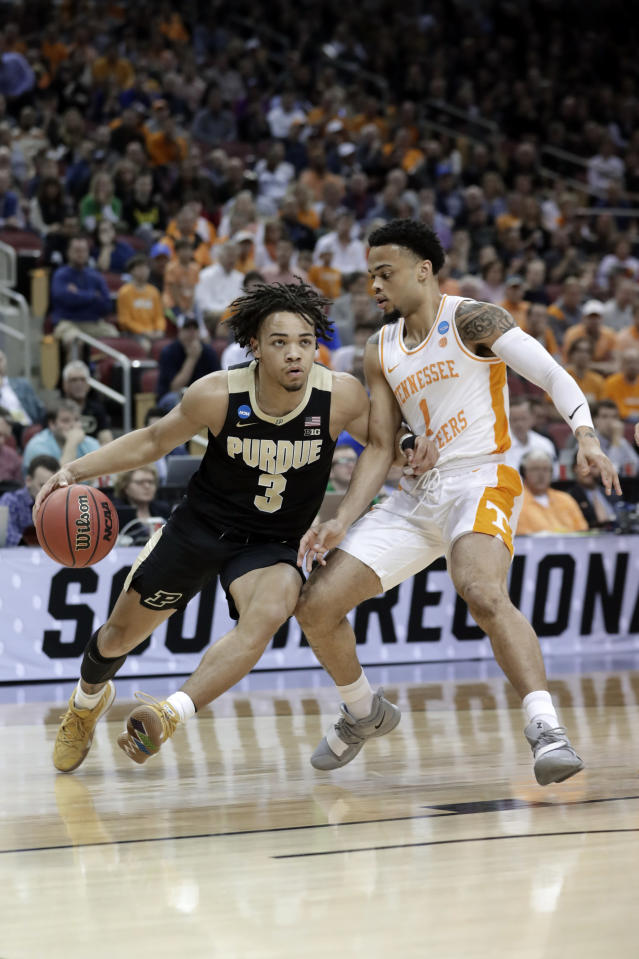 <p>Purdue's Carsen Edwards (3) drives against Tennessee guard Lamonte Turner (1) during the first half of a men's NCAA Tournament college basketball South Regional semifinal game Thursday, March 28, 2019, in Louisville, Ky. (AP Photo/Michael Conroy) </p>