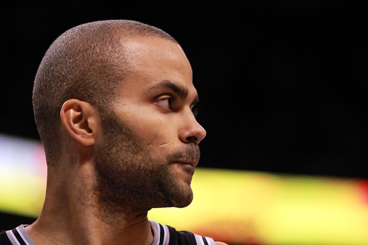 OKLAHOMA CITY, OK - MAY 31:  Tony Parker #9 of the San Antonio Spurs looks on in the second half while taking on the Oklahoma City Thunder in Game Five of the Western Conference Finals of the 2012 NBA Playoffs at Chesapeake Energy Arena on May 31, 2012 in Oklahoma City, Oklahoma. NOTE TO USER: User expressly acknowledges and agrees that, by downloading and or using this photograph, User is consenting to the terms and conditions of the Getty Images License Agreement.  (Photo by Ronald Martinez/Getty Images)