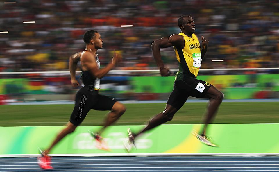 RIO DE JANEIRO, BRAZIL - AUGUST 17: Andre de Grasse of Canada and Usain Bolt of Jamaica react as they compete in the Men's 200m Semifinals on Day 12 of the Rio 2016 Olympic Games at the Olympic Stadium on August 17, 2016 in Rio de Janeiro, Brazil. (Photo by Ian MacNi/Getty Images)