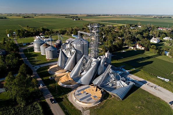 In this aerial image from a drone, damaged grain bins are shown at the Heartland Co-Op grain elevator in Luther, Iowa.