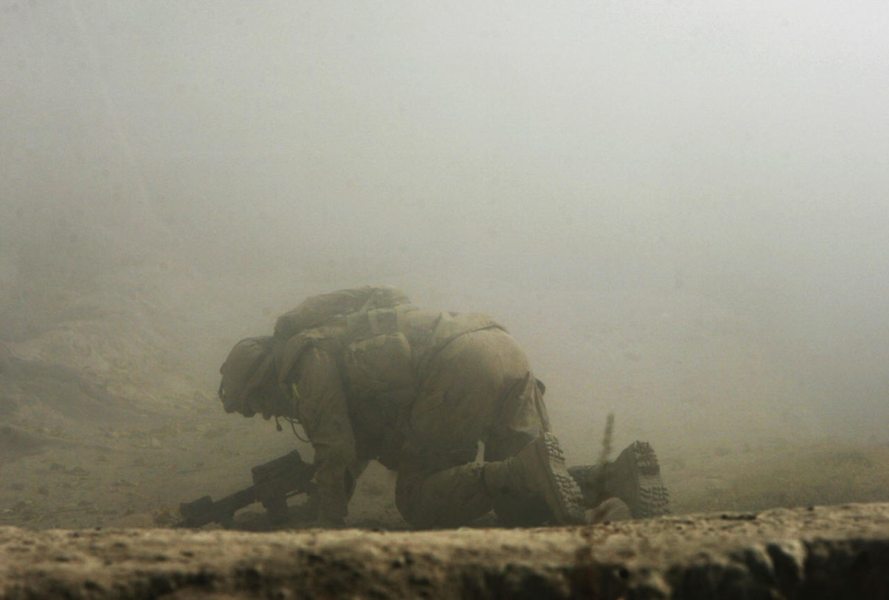 <p>A wounded Canadian soldier from the NATO-led coalition crawls for cover seconds after his position was hit by a Taliban shell fired from an 82-millimeter recoilless rifle during an ambush in Zhari district of Kandahar province, southern Afghanistan, Oct. 23, 2007. (Photo: Finbarr O'Reilly/Reuters) </p>