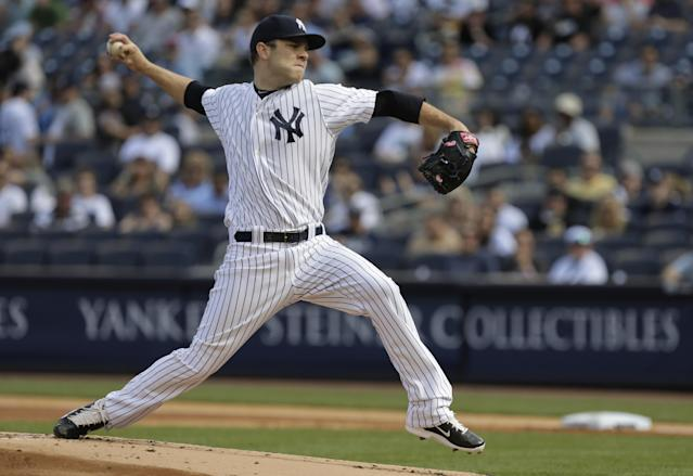 New York Yankees relief pitcher David Phelps delivers against the Pittsburgh Pirates during the first inning of a baseball game, Saturday, May 17, 2014, in New York. (AP Photo/Julie Jacobson)
