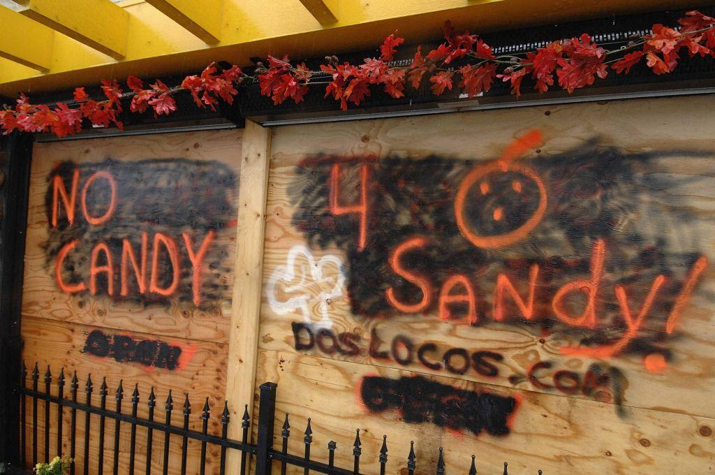 Boarded-up businesses sport Halloween-themed messages on the deserted boardwalk as Hurricane Sandy approaches Rehoboth Beach, Delaware. Hurricane Sandy, the monster storm bearing down on the U.S. East Coast, strengthened on Monday after hundreds of thousands moved to higher ground, public transport shut down and the U.S. stock market suffered its first weather-related closure in 27 years.