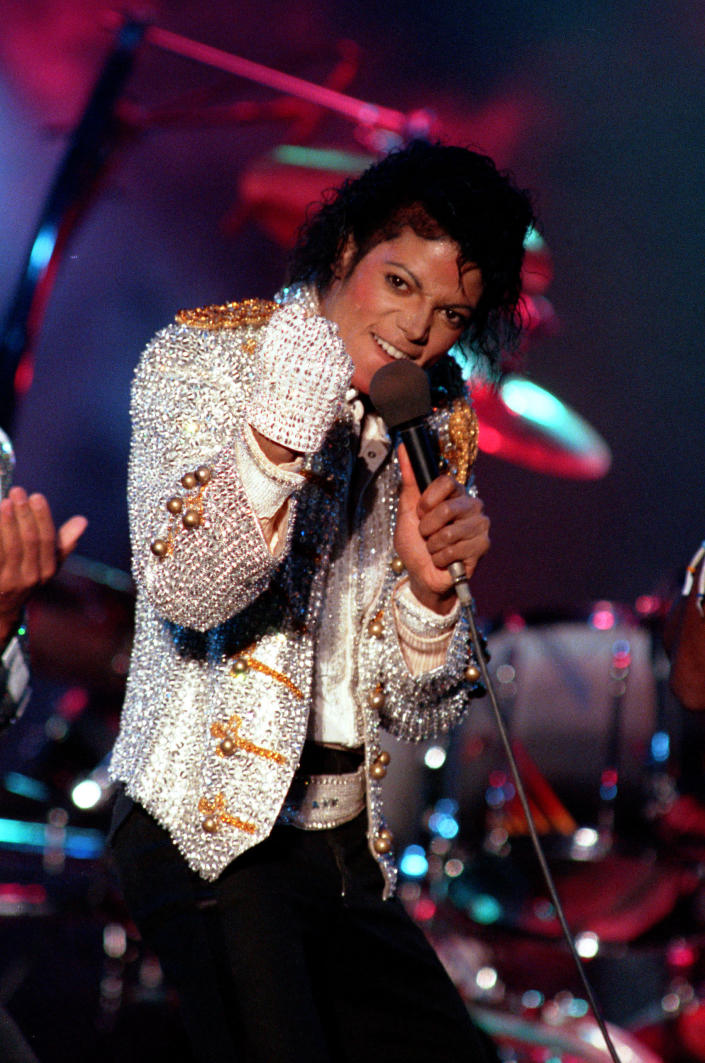"""FILE - In this Dec. 3, 1984 photo, Michael Jackson performs with his brothers at Dodger Stadium in Los Angeles, as part of their Victory Tour concert. Michael Jackson accusers Wade Robson and James Safechuck say that the Sundance Film Festival is first time they've ever felt public support for their allegations the King of Pop molested them. The documentary """"Leaving Neverland,"""" which premiered at the festival in Jan. 2019, and will air on HBO in two parts on March 3 and 4, chronicles how their lives intersected with Jackson's. (AP Photo/Doug Pizac, File)"""
