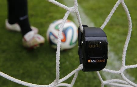 """A GoalControl watch reads """"goal"""" as a football rolls fully behind the goal line during a demonstration in the western German city of Aachen May 28, 2014. REUTERS/Wolfgang Rattay"""